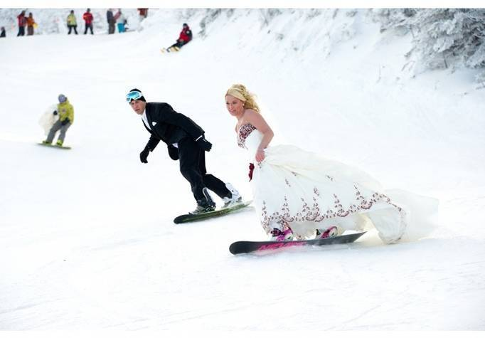 snowboarding in a wedding dress