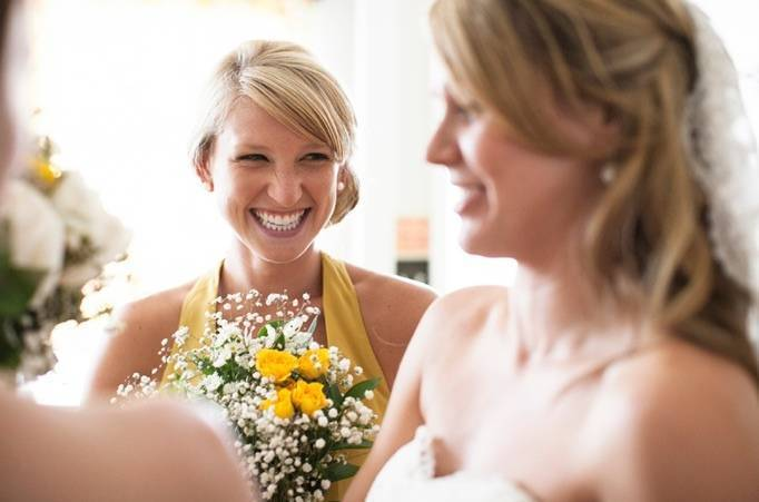 yellow bridesmaid dress and bouquet