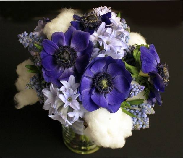 purple anemone bouquet with cotton details