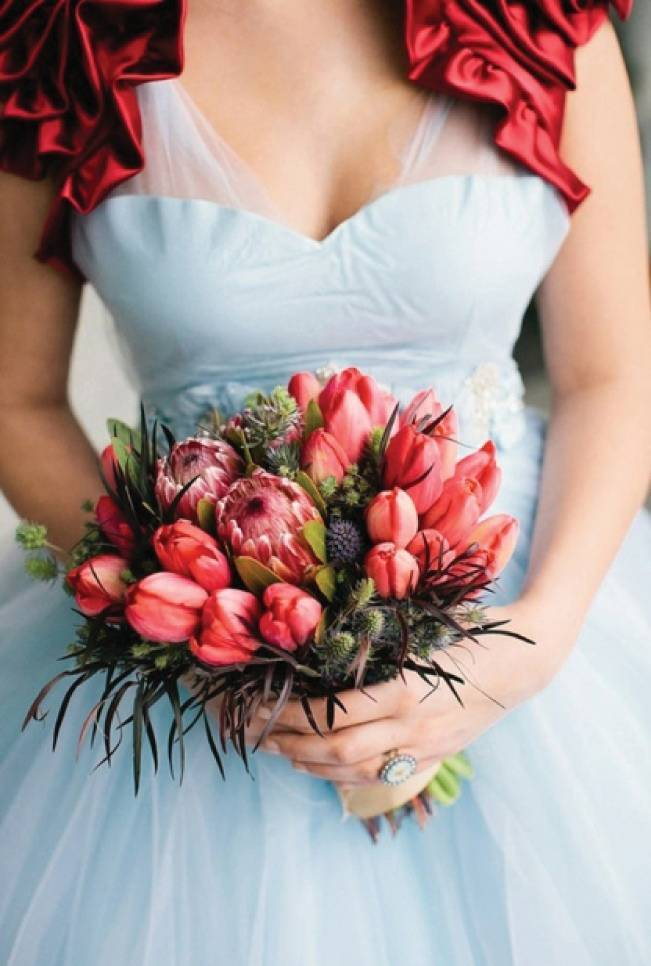red tulip bouquet and protea bouquet