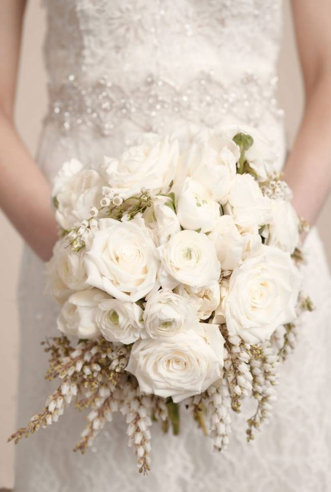 white ranunculus and berry wedding bouquet