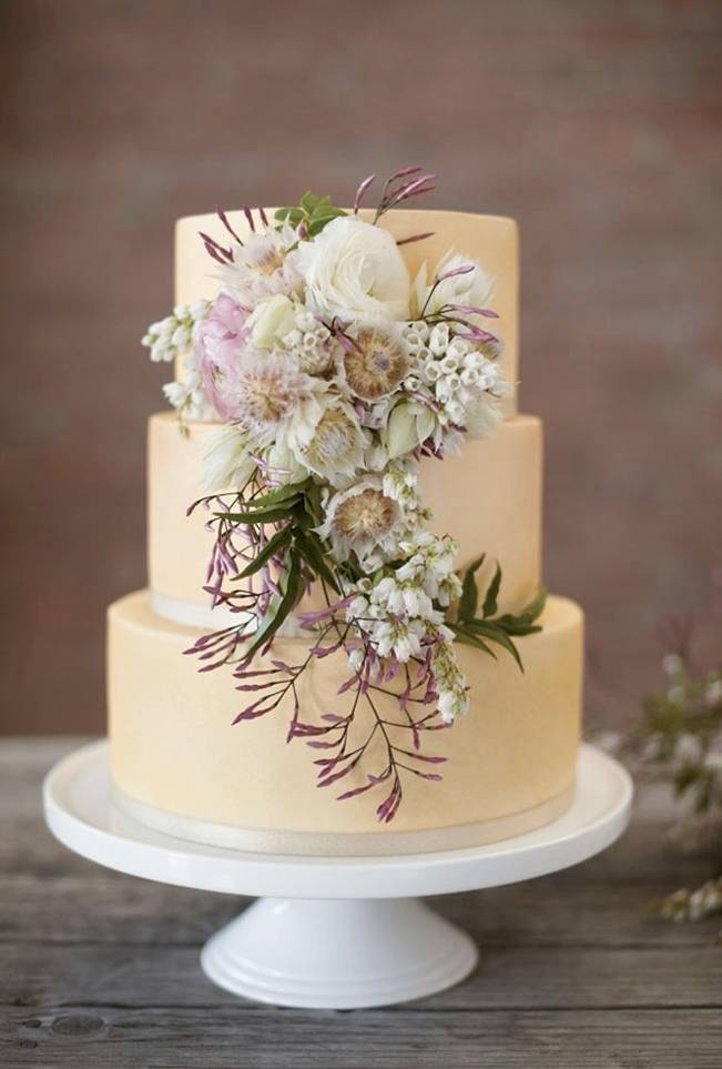 spring wedding cake with jasmine flowers