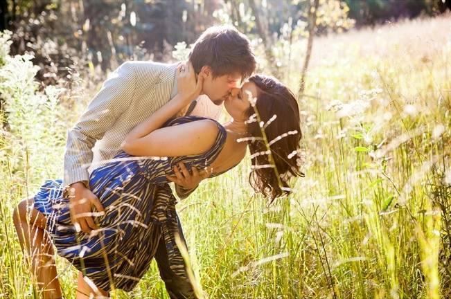 kissing in a field