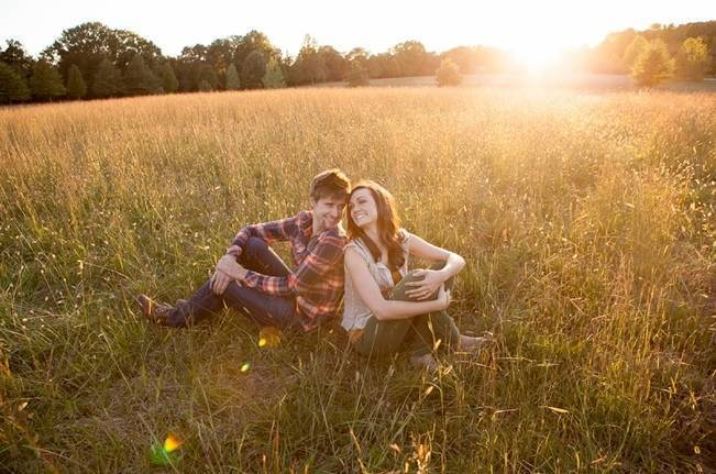 sunset in a field engagement photo