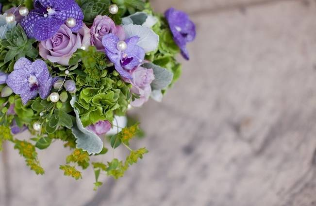 purple haze roses, green hydrangea, purple vanda orchids, dusty miller, freesia