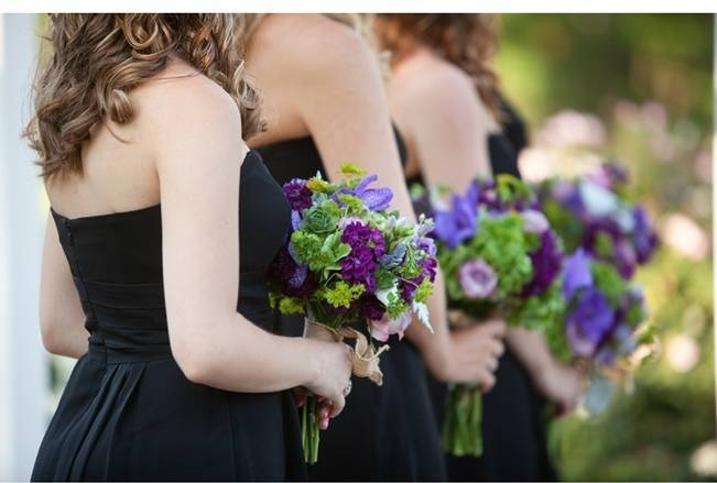 green and purple bridesmaid bouquets, black bridesmaid dresses