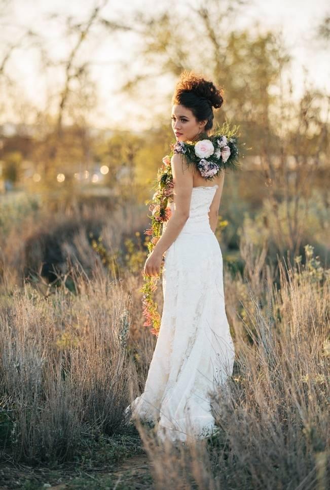 bride in field with flower vine