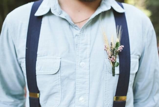 groom with suspenders