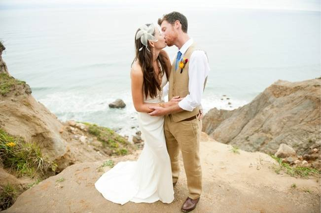 bride and groom on beach cliffs