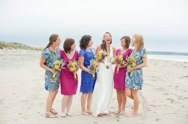 pink and blue bridesmaids on beach