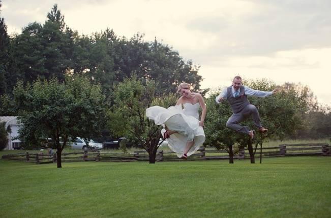 bride and groom kicking up their heels