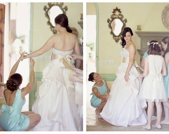 bridesmaids dressing bride