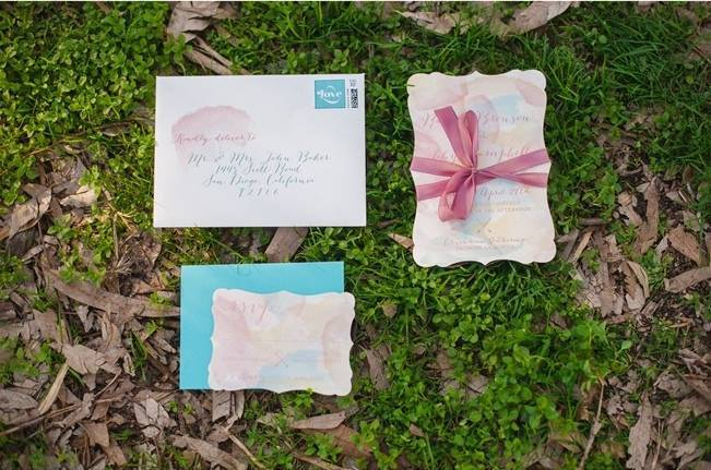 pink and blue watercolor wedding invites