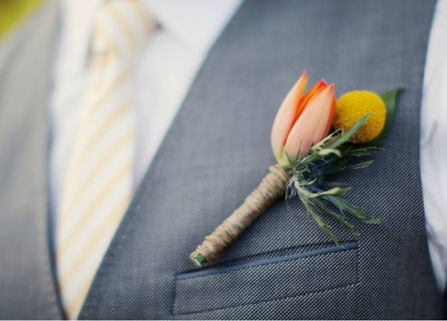 orange and yellow boutonniere