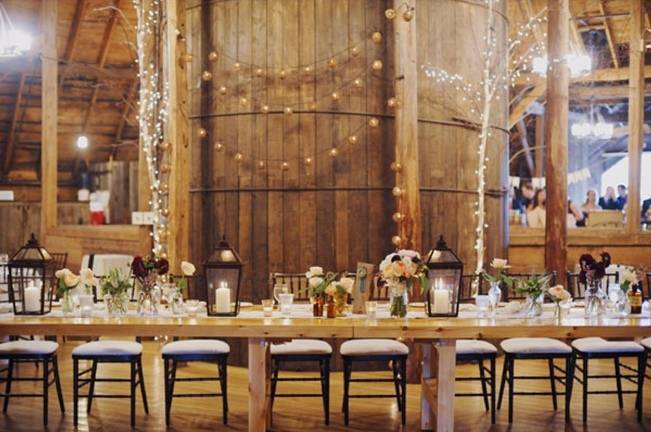 rustic barn wedding reception with lanterns and twinkle lights