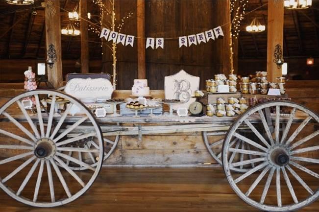 wagon wheel rustic wedding dessert table