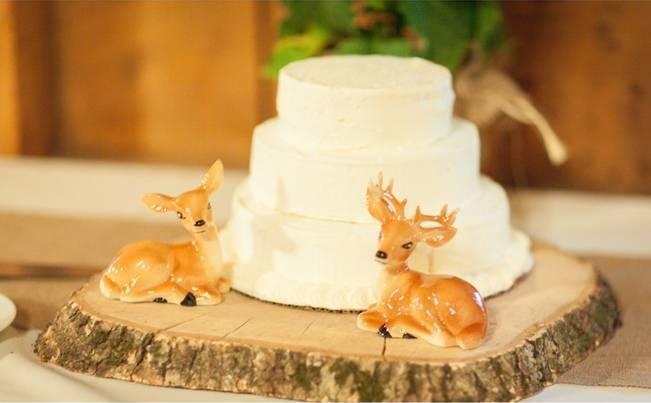 rustic wedding cake with woodland deer