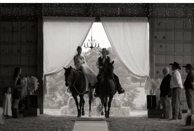 bride and groom on horseback