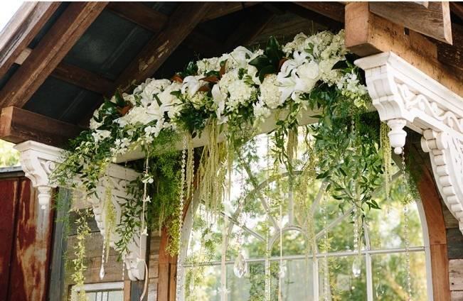 lush blooms wedding arbor