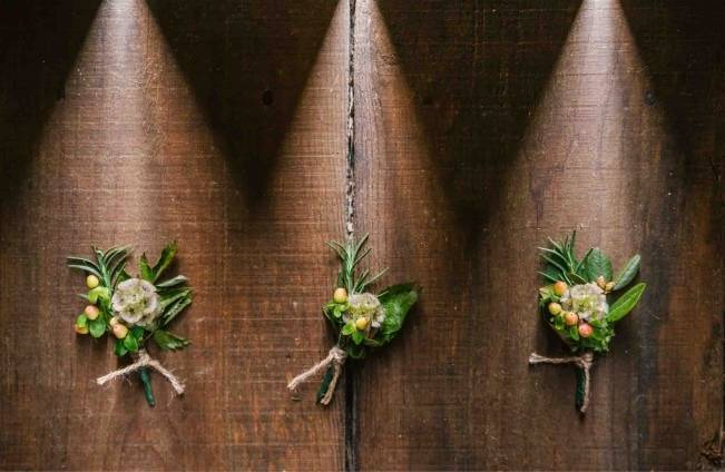 rustic boutonnieres with berries