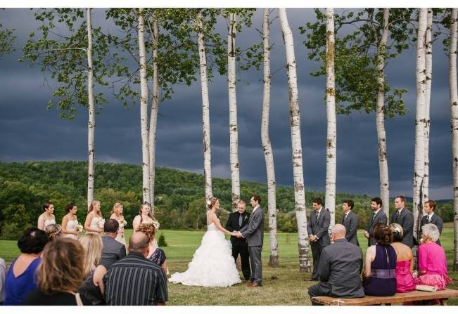 rainy wedding ceremony dark sky