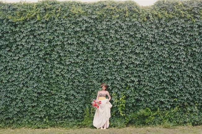 wall of ivy with bride