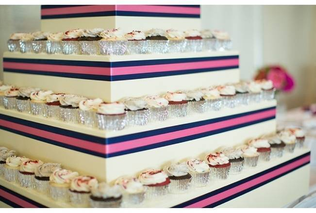 pink and navy blue cupcake tower
