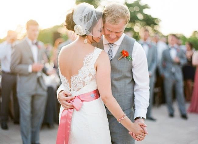 wedding dress with pink satin sash