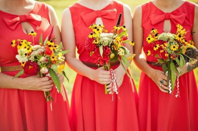 red bridesmaid dresses and yellow bouquets