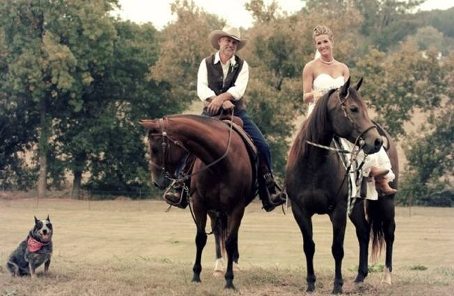 bride and groom riding horses
