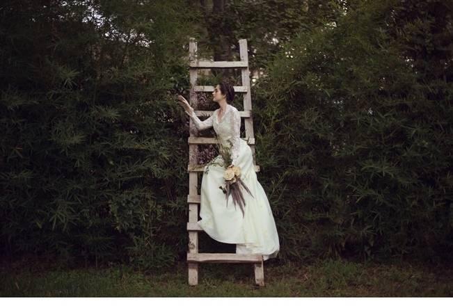 bride on ladder in the garden