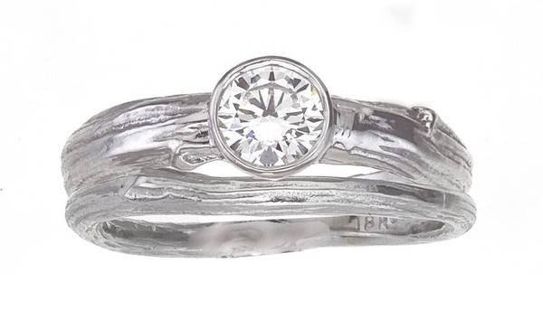 Bucolic setting ring – round bezel set diamond on branch band with narrower twig wedding ring