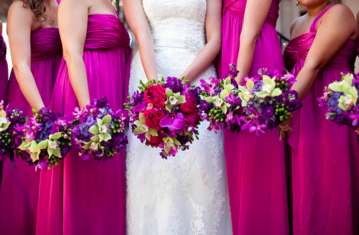 hot-pink-bridesmaids-dresses-long-tropical-bouquets.original